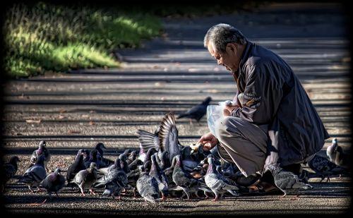 Man feeding birds